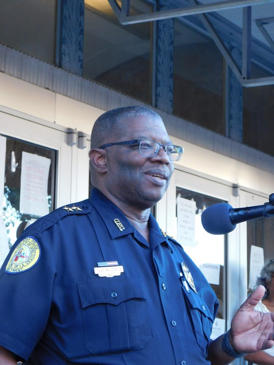 Opelousas Police Chief Martin McLendon speaks to a group of protesters after one of his white officers is accused of excessive force against a black teen.