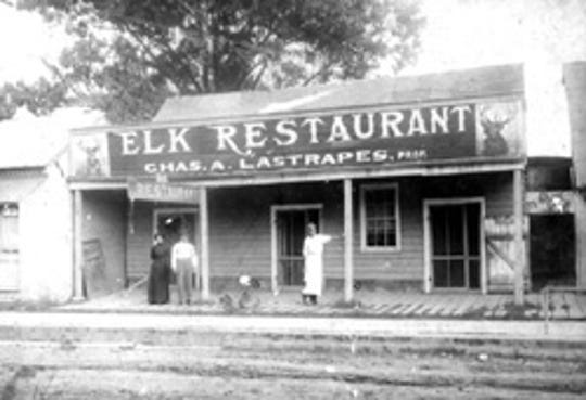 "Elk Restaurant, operated by Charles ""Didee"" Lastrapes, shown here during the early 1900s on the corner of Court and Bellevue's streets (Budd's Corner) in downtown Opelousas."
