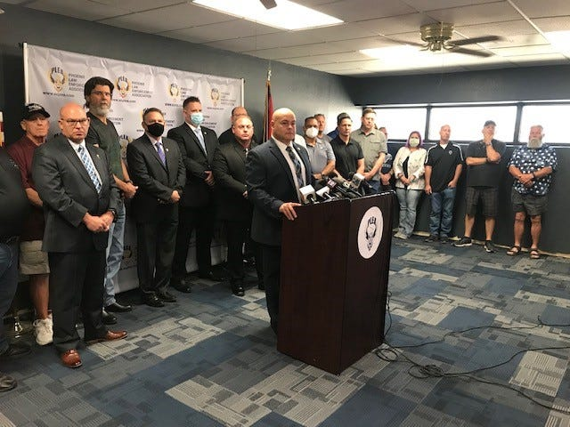 Britt London, president of the Phoenix Law Enforcement Association, held a press conference to ask for more support of Phoenix police officers as protests against police brutality and demands to defund police continue in Phoenix and across the U.S., June 12, 2020.