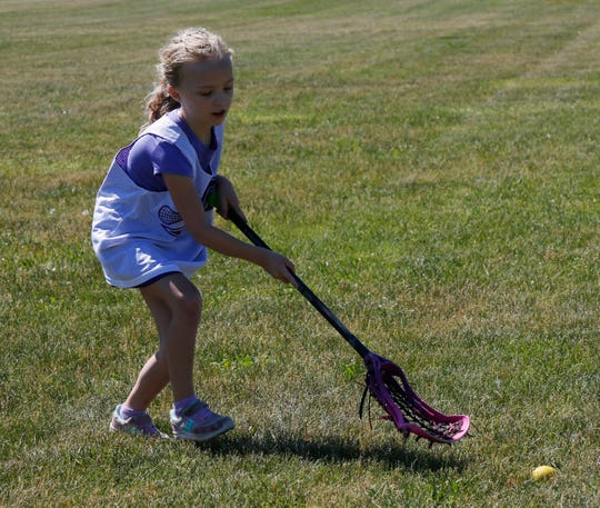 Elizabeth Schmitt practices with her father Dan at Stringham Park in LaGrangveville on June 12, 2020.