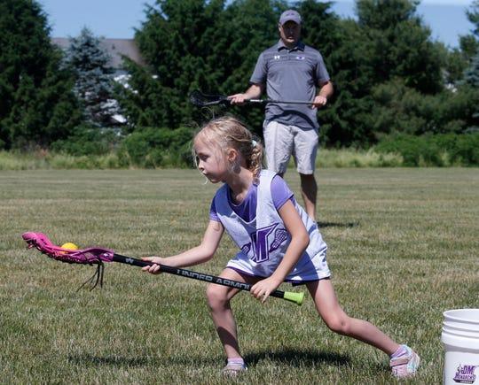 Dan Schmitt practices with his daughter Elizabeth at Stringham Park in LaGrangveville on June 12, 2020.