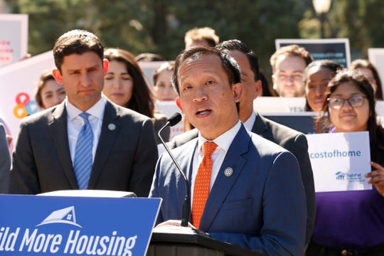 """In this Feb. 24, 2020, file photo, Assemblyman David Chiu, D-San Francisco, chairman of the Assembly Housing Committee, center, speaks during a news conference, in Sacramento. California judicial leaders are considering an early end to statewide emergency orders suspending foreclosures and evictions during the coronavirus pandemic, prompting objections from lawmakers and advocates, including Chiu, that they may be acting too soon and disproportionately harming minorities in the midst of civil unrest over the deaths of black people at the hands of police. The state's Judicial Council in early April delayed all eviction cases from moving forward as one of 13 steps responding to the pandemic. """"Millions of Californians are hanging on by a thread financially,"""" he said in a statement."""