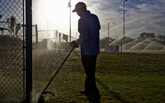 Kevin Celaya trims the grass at the Texas Bank Sports Complex in San Angelo on Thursday, June 11, 2020. The facility will see no change in the amount of funding received from the city's Hotel Occupancy Tax.