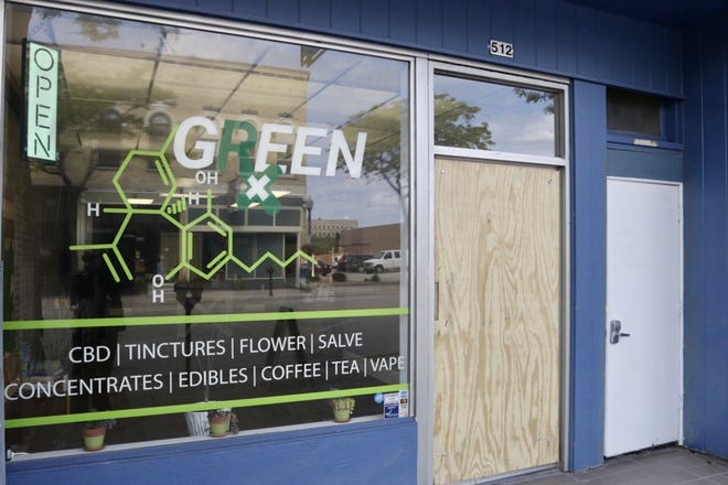 Green Rx's door was damaged in a burglary Tuesday, June 9, 2020.