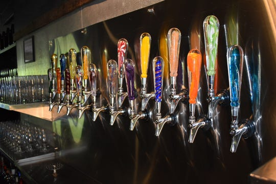 Red River Brewpub's new glass beer taps were blown by Sanctuary Glass Studio.