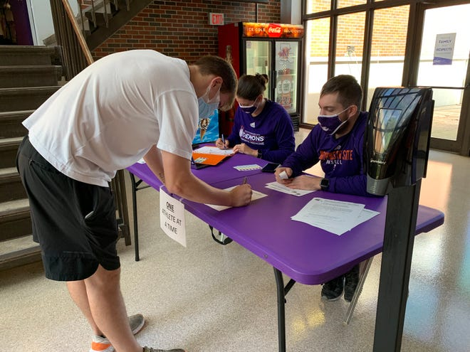 Photo attached of an NSU student-athlete checking in at the fieldhouse.