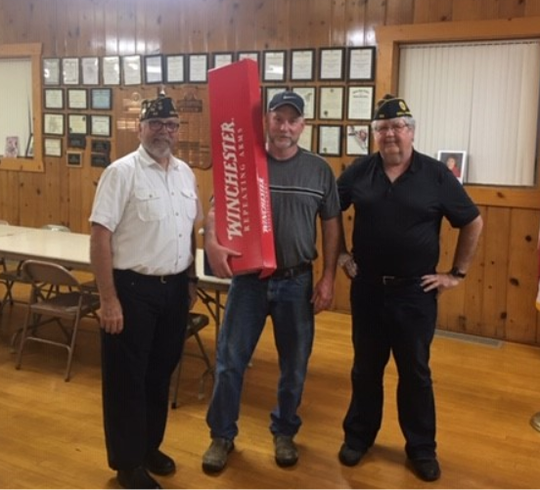 Dell Rapids Post 65 Commander Larry Hoyme (left) shotgun raffle winner Vince Devlin (center) and former commander Steve Sittig.