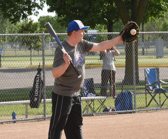 St. Cloud Blue Sox president Dan Heiser prepares to hit a ball during a fielding drill Thursday, June 11, 2020, at Whitney Park in St. Cloud.