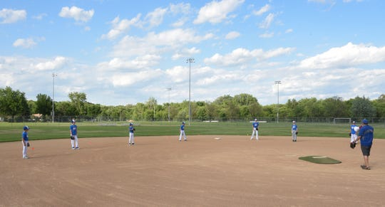Blue Sox players make sure to maintain their distance during drills Thursday, June 11, 2020, at Whitney Park in St. Cloud.