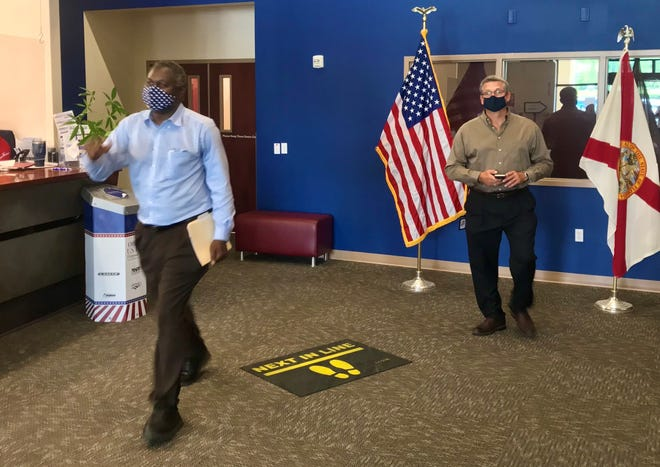 Leon County Property Appraiser Akin Akinyemi, left, leaves the Supervisor of Elections office Friday after qualifying for the ballot. Both he and Supervisor of Elections Mark Earley, right, were re-elected automatically after drawing no challengers by the end of the qualifying period.