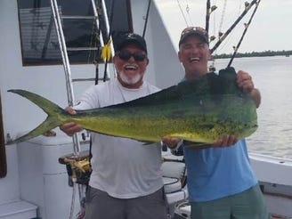 Capt. Billy Black of Stuart, left, is eager to fish for dolphin, wahoo, tuna and blue marlin in Bahamian waters beginning June 15, 2020.