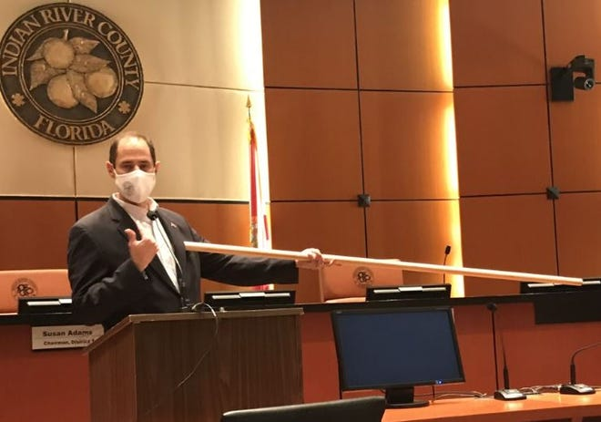 Indian River County Administrator Jason Brown uses 6-foot pole to illustrate the need for social distancing to prevent the spread of COVID -19 during a briefing Friday, June 12, 2020, in the County Commission Chambers.