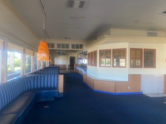 Carrows closed its Ventura location last summer. The former dining room is seen in a photo taken through dust-covered windows on May 21.