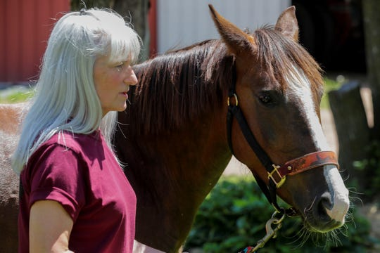 Nala, a mustang, looks on as Denice Feit talks during an interview on Friday, June 5, 2020, at her farm outside of Knowlton, Wis. Feit won the chance to adopt Nala after writing an essay for a contest set up by a horse trainer in Florida.