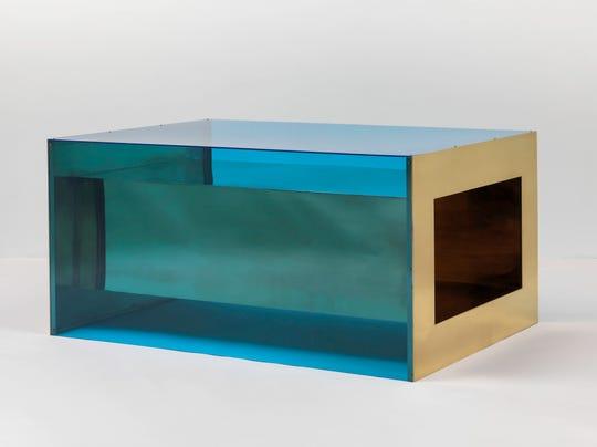 Donald Judd. Untitled. 1973. Brass and blue Plexiglas, 33 × 68 × 48″ (83.8 × 172.7 × 121.9 cm). Solomon R. Guggenheim Museum, New York, Panza Collection, 1991 © 2020 Judd Foundation / Artists Rights Society (ARS), New York