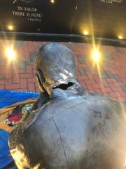 """Delaware's law enforcement memorial, which was erected in 2010 to honor the state'sfallen law enforcement officers, was axed Friday morning and twostate flags """"soaked"""" in urine were left nearby, Dover police said."""