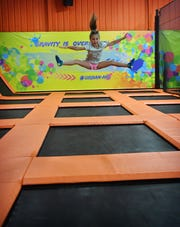 Paisley Teel, 5, practices her trampoline jumps at Urban Air Adventure Park Friday during an event for essential workers and their families as the park reopens to public Saturday.
