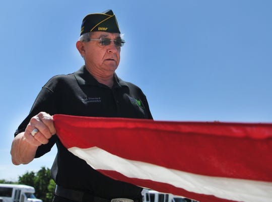 "Wichita Falls DAV commander Joel Jiminez prepares a flag Friday morning for their upcoming ""Pause for the Pledge"" event to be held on the north side of Memorial Stadium on Sunday, June 14 at 6 p.m."