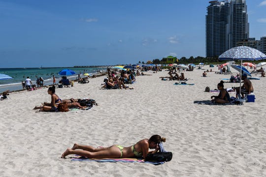 Miami beaches opened June 10, 2020, where staff were present to remind visitors of social distancing guidelines.