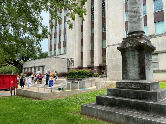 People protest police brutality and the death of George Floyd in Minneapolis at the Rapides Parish Courthouse on June 2. Not far from them is a statue honoring dead Confederate soldiers, which one Alexandria City Council members wants removed.