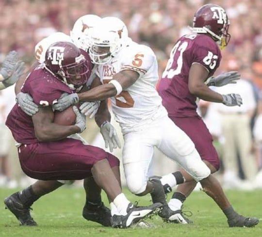 Texas defensive back Ahmad Brooks (5) makes a tackle against Texas A&M.
