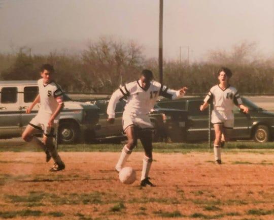 Ahmad Brooks (17), a 1998 Abilene High grad, dribbles during a soccer game.