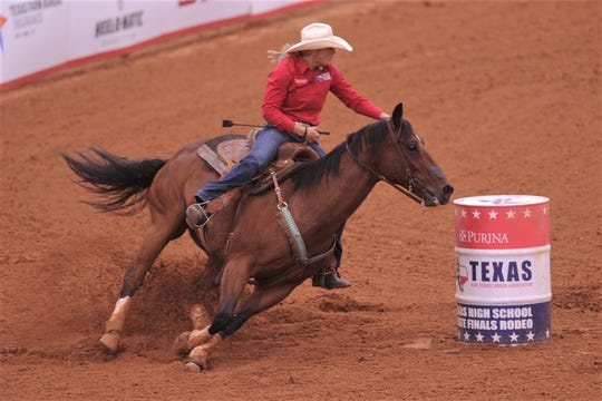 Abilene's Bradi Good and her horse, Junior, round the second of three barrels in the barrel racing event in the short-go at the Texas High School Rodeo Association State Finals on Saturday at Taylor Telecom Arena. Good finished second overall to earn her third trip to nationals.