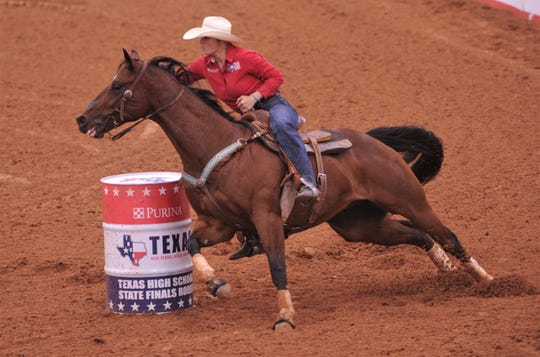 Abilene's Bradi Good and her horse, Junior, round the first of three barrels in the barrel racing event during the short-go at the Texas High School Rodeo Association's State Finals on Saturday at Taylor Telecom Arena. Good finished second overall to earn her third straight trip to nationals.