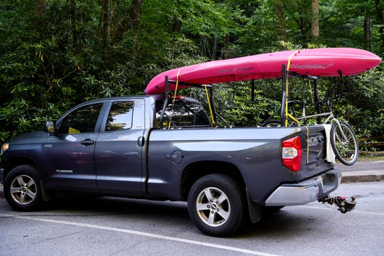 A kayak and a bike are attached to a parked truck in Pisgah National Forest in Brevard June 12, 2020.