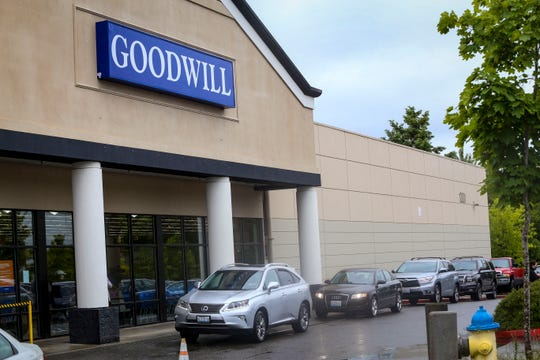 A lineup of cars filled with items for donation wraps around the Goodwill in Silverdale on Friday. Goodwill manager Eric Moe said there are often 30-40 cars waiting in line at once.