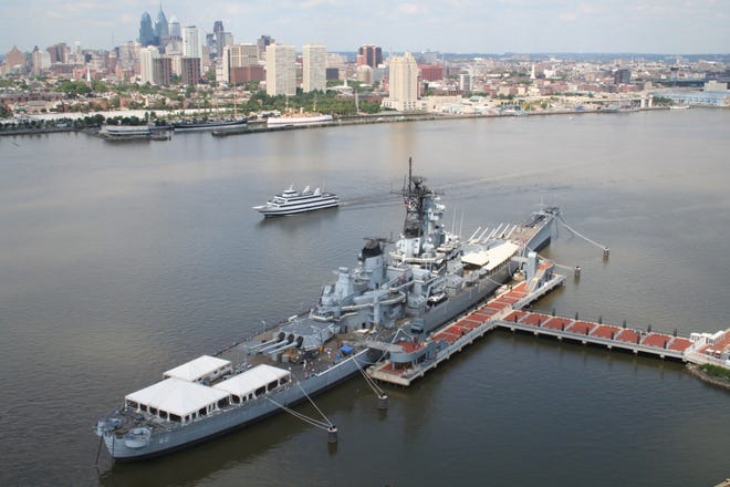 Battleship New Jersey Museum and Memorial sits at its own pier on the Delaware River in Camden and across from the Philadelphia riverfront and skyline. It is reopening Monday for limited tours after a coronavirus-related closure since March ,