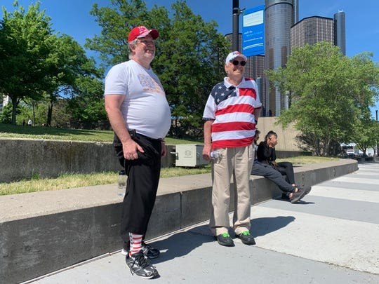 Bill Carver, of Harrison Township, shows off his Trump socks alongside Dan McGinnis, of St. Clair Shores, while cheering on boats participating in the nautical parade in honor of President Trump's 74th birthday.