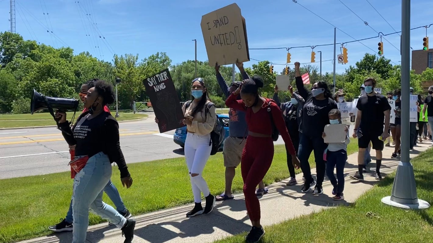 Protesters march at Lawrence Tech after 'All Lives Matter' post