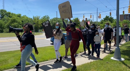 """Lawrence Technological University students lead a march on 10 Mile Road Saturday after """"All Lives Matter"""" was posted on the University's Instagram account and later removed."""