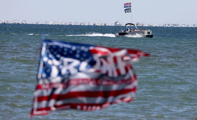 A flotilla of boats supporting President Trump pass by Veterans Memorial Park in St. Clair Shores on Saturday, June 13, 2020 and head down Lake St. Clair towards the Detroit River. Over 300 boats with President Trump supporters on board and sailing with Trump 2020 flags went from Northern Macomb County on a choppy Lake St. Clair and into the Detroit River ending at the Ambassador Bridge The flotilla of boats organized by Michigan Conservative Coalition and Michigan Trump Republicans 2020 sailed in support of Trump and to recognize his 74th birthday which is on Sunday, June 14.