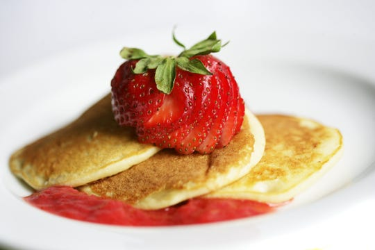 Ricotta Cheese Pancakes with Strawberry Rhubarb compote .