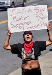 Protestors gather outside the Wendy's fast food restaurant in Atlanta on Saturday where Rayshard Brooks, a 27-year-old black man, was shot and killed by Atlanta police Friday evening during a struggle in a drive-thru line.