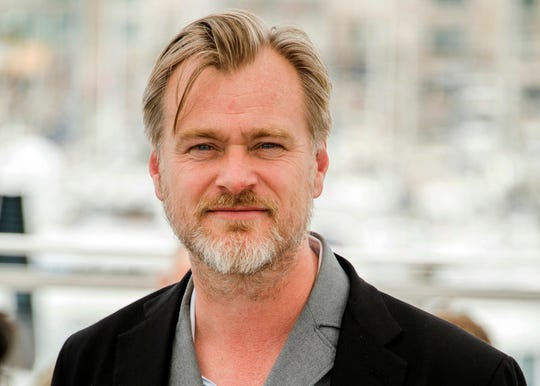 "Christopher Nolan poses during a photo call at the 71st international film festival in Cannes, southern France. Warner Bros. says it will release Nolan's latest film, the sci-fi espionage spectacle ""Tenet,"" in theaters on July 31, 2020."