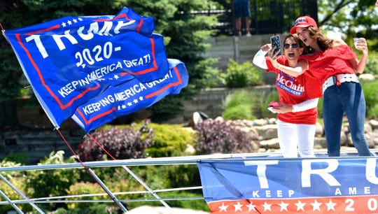 Lisa McClain, left, of Romeo, and co-organizer Rachel Keena, of Oakland Township, take a selfie as they leave MacRay Marina. McClain is a candidate for U.S. Congress in Michigan's 10th district.