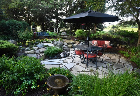 English Gardens designed the terrace area. Steven and Kathy installed the meditation area right behind it.