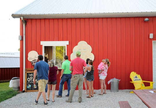 Families line up to order ice cream at Flora June's Scoop Shoppe in Fort Branch on Thursday, June 11, 2020.
