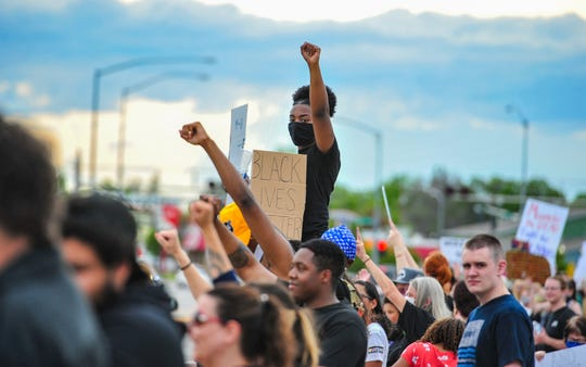 Black Lives Matter protesters rally along Central Avenue West in front of the Missouri River Federal Courthouse on Friday, June 12, 2020.