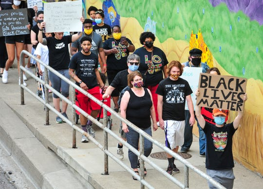 Black Lives Matter protesters march from the Civic Center to the Missouri River Federal Courthouse on Friday, June 12, 2020.