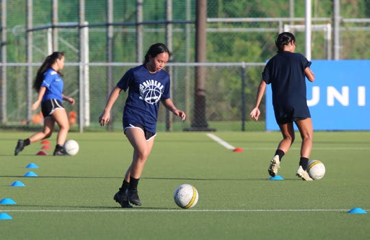 Victoria Rapadas and other players participate in a U17 Women's National Team training session June 11 at the Guam Football Association National Training Center. GFA is set to expand training Monday to include Elite Selection youth teams.