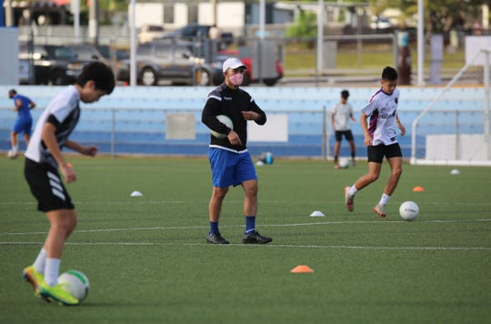 Coach Dominic Gadia conducts a U17 National Team training session June 10 at the Guam Football Association National Training Center. GFA is set to expand training Monday to include Elite Selection youth teams.