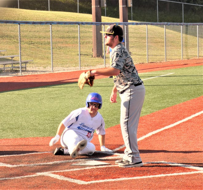 Lancaster Post 11's Brody Post slides safely into home as Waverly Post 142 pitcher Derek Eblin awaits the throw during the first game of a doubleheader Friday night at Beavers Field.