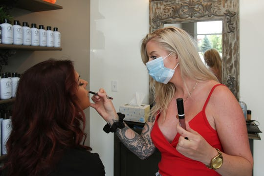 Makeup artist Katie Painter applies makeup on The Parlor Hair Salon owner Liberty McKee at the Howell salon, Friday June 12, 2020. The salon will reopen Monday.