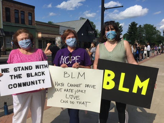 Haley Comella (right) organized a protest against racism in her home town of Pinckney, Friday, June 12, 2020. Family members who joined her included her grandmother Janet Blow (left) and mother Janine Comella (center).