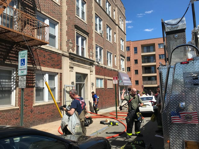 Firefighters pack up after extinguishing a fire on Lincoln Avenue in Cliffside Park. June 13, 2020