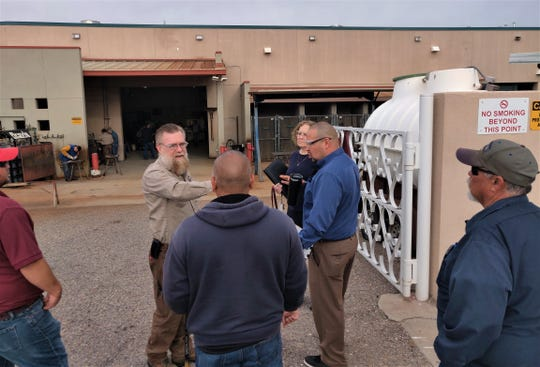 DACC Welding Technology Associate Professor Pep Gómez works with Miguel Fernandez, SCSWA recycling services administrator, while scouting the welding bays at DACC.